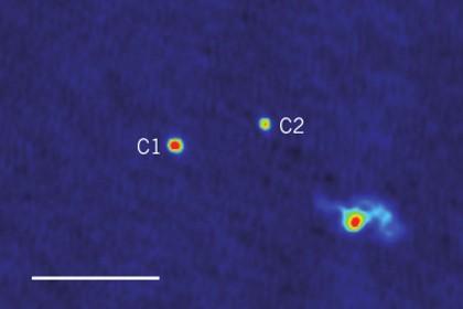 Астрономы обнаружили три сверхмассивные черные дыры, вращающиеся друг вокруг друга